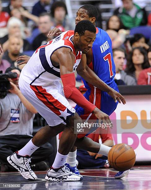 Washington Wizards point guard John Wall collects a turnover by Detroit Pistons point guard Brandon Knight during secondhalf action at the Verizon...