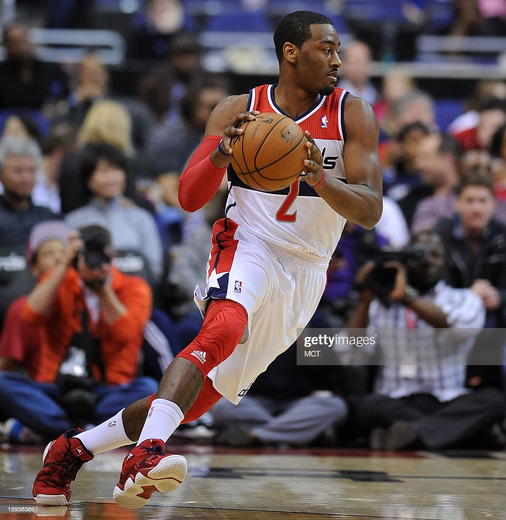 Washington Wizards point guard John Wall (2) dribbles against the Atlanta Hawks in the first quarter at the Verizon Center in Washington, D.C., Saturday, January 12, 2013.