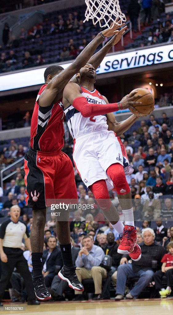 Washington Wizards point guard John Wall (2) drives and shoots against Toronto Raptors power forward Amir Johnson (15) during the second half of their game played at the Verizon Center in Washington, D.C., Tuesday, February 19, 2013. Toronto defeated Washington 96-88.