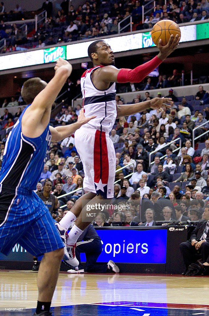 Washington Wizards point guard John Wall drives to the basket for a shot past Orlando Magic power forward Ryan Anderson during the second half of...