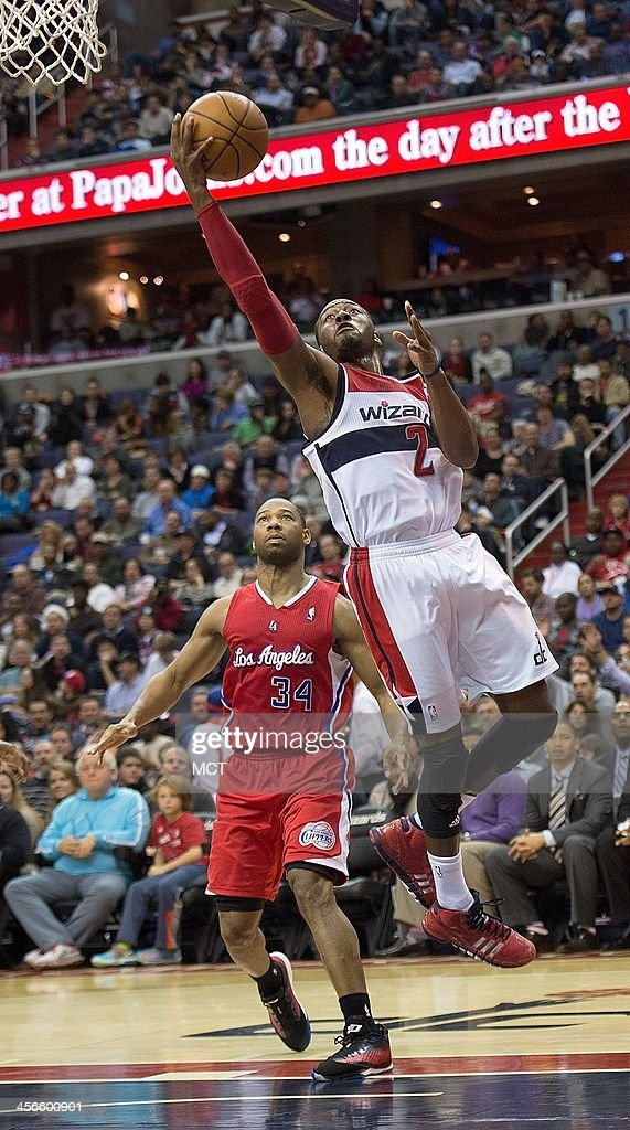 Washington Wizards point guard John Wall (2) scores after getting by Los Angeles Clippers shooting guard Willie Green (34) during the second half of their game played at the Verizon Center in Washington, Saturday, Dec. 14, 2013. Los Angeles defeated Washington 113-97.