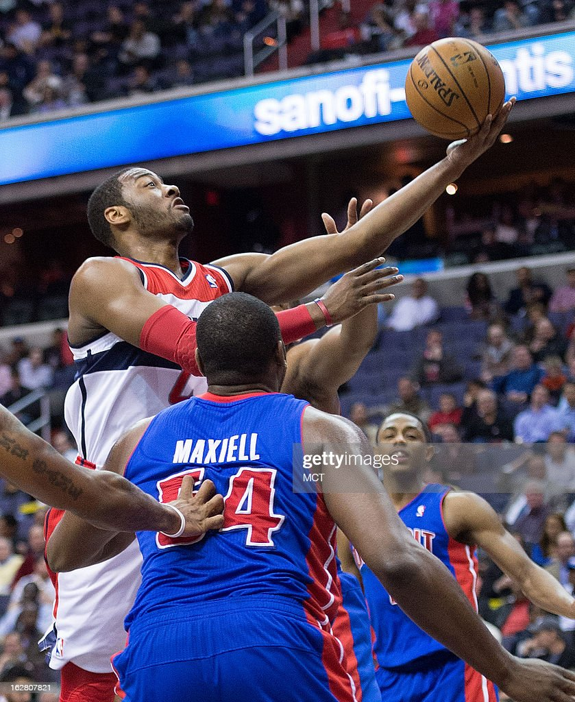 Washington Wizards point guard John Wall (2) scores on a layup over Detroit Pistons power forward Jason Maxiell (54) during the second half of their game played at the Verizon Center in Washington, D.C., Wednesday, February 27, 2013. Detroit defeated Washington 96-95.
