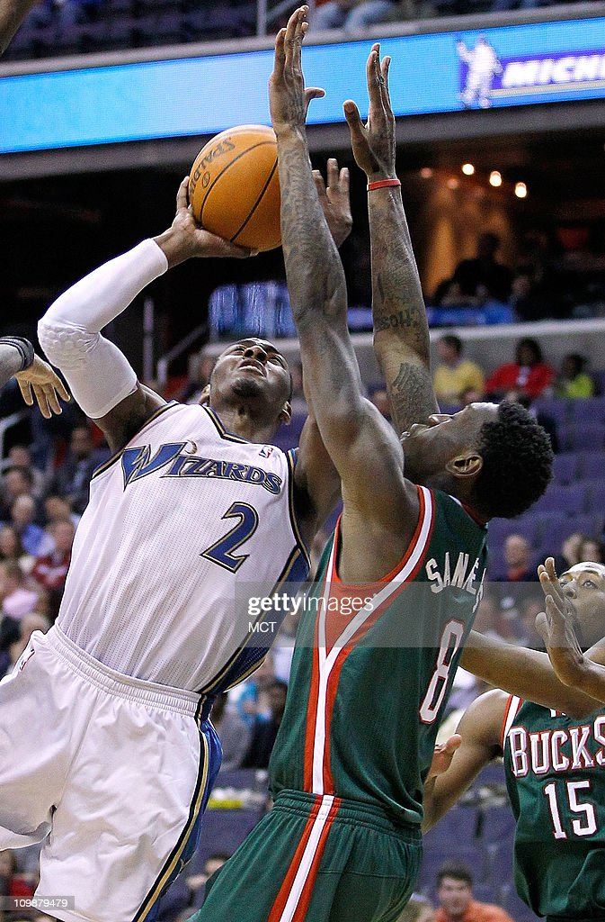 Washington Wizards point guard John Wall (2) shoots against Milwaukee Bucks power forward Larry Sanders (8) during their game played at the Verizon Center in Washington, D.C., Tuesday, March 8, 2011. Milwaukee defeated Washington 95-76.