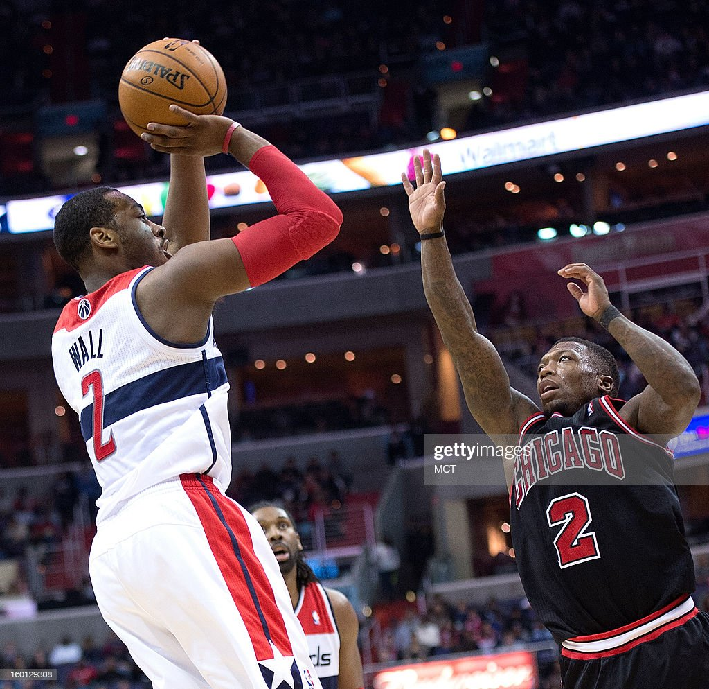 Washington Wizards point guard John Wall (2) shoots over Chicago Bulls point guard Nate Robinson (2) during the second half of their game played at the Verizon Center in Washington, D.C., Saturday, January 26, 2013. Washington defeated Chicago 86-73.