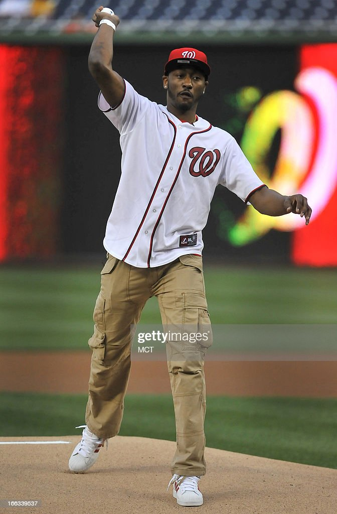 Washington Wizards point guard John Wall throws out the first pitch for the Washington Nationals vs. Chicago White SoxÕs baseball game at Nationals Park in Washington, D.C., Thursday, April 11, 2013.