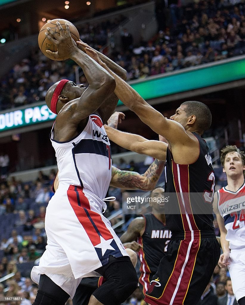 Washington Wizards power forward Al Harrington (7) shoots while being defended by Miami Heat small forward Shane Battier (31) during the second half of their preseason game played at the Verizon Center in Washington, D.C., Tuesday, October 15, 2013. Washington defeated Miami 100-82.