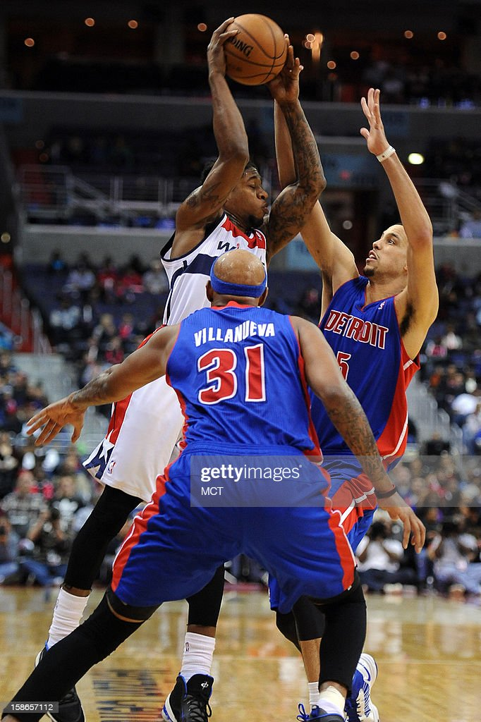 Washington Wizards power forward Cartier Martin (20) passes out of a double team by Detroit Pistons power forward Austin Daye (5) and Pistons power forward Charlie Villanueva (31) in the fourth quarter at the Verizon Center in Washington, D.C., Saturday, December 22, 2012. The Pistons defeated the Wizards, 96-87.