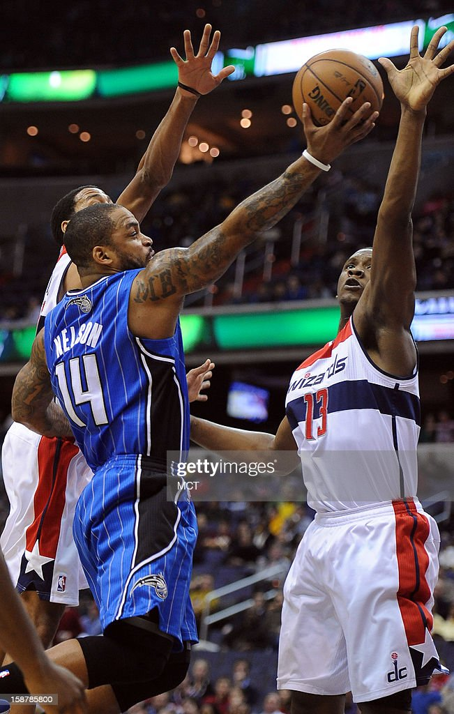 Washington Wizards power forward Kevin Seraphin (13) blocks a shot by Orlando Magic point guard Jameer Nelson (14) in the first half at the Verizon Center in Washington, D.C., Friday, December 28, 2012.