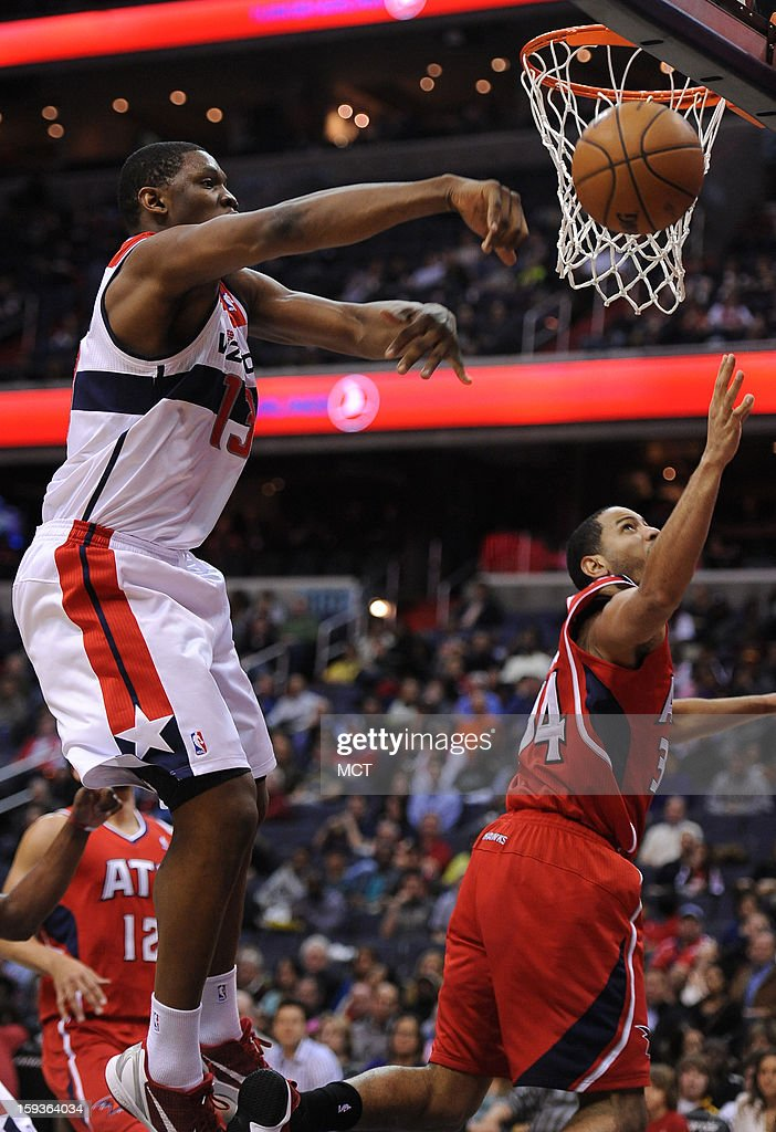 Washington Wizards power forward Kevin Seraphin (13) blocks a shot by Atlanta Hawks point guard Devin Harris (34) in the second quarter at the Verizon Center in Washington, D.C., Saturday, January 12, 2013.