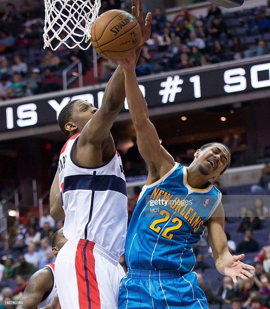Washington Wizards power forward Kevin Seraphin blocks the shot of New Orleans Hornets point guard Brian Roberts during the second half of their game...