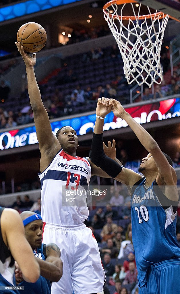 Washington Wizards power forward Kevin Seraphin (13) scores over Minnesota Timberwolves small forward Chase Budinger (10) during the second half of their game played at the Verizon Center in Washington, D.C., Friday, January 25, 2013. Washington defeated Minnesota 114-101.