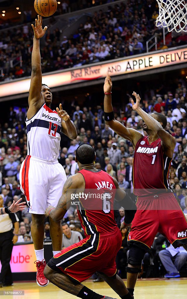 Washington Wizards power forward Kevin Seraphin (13) shoots over Miami Heat small forward LeBron James (6) and Heat center Chris Bosh (1) in the fourth quarter at the Verizon Center in Washington, D.C., Tuesday, December 4, 2012. The Wizards defeated the Miami, 105-101.