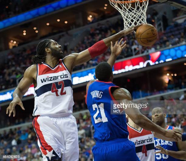 Washington Wizards power forward Nene Hilario blocks the shot of Philadelphia 76ers power forward Thaddeus Young during the first half of their game...