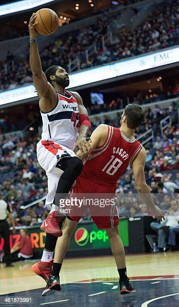 Washington Wizards power forward Nene Hilario shoots over Houston Rockets small forward Omri Casspi during the second half of their game played at...