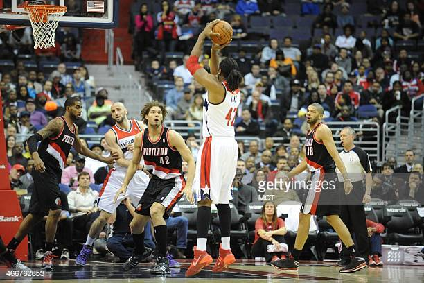 Washington Wizards power forward Nene Hilario takes a jump shot during the first half against the Portland Trail Blazers at the Verizon Center in...