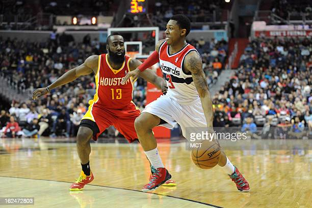 Washington Wizards shooting guard Bradley Beal dribbles by Houston Rockets shooting guard James Harden during firsthalf action at the Verizon Center...