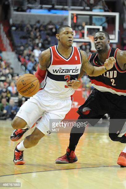 Washington Wizards shooting guard Bradley Beal dribbles the ball by Portland Trail Blazers shooting guard Wesley Matthews during the second half at...