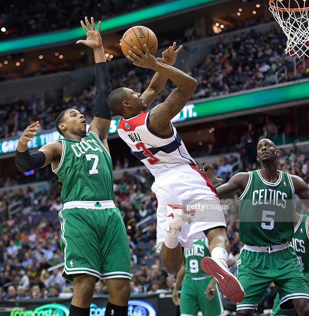 Washington Wizards shooting guard Bradley Beal (3) drives to the basket between Boston Celtics power forward Jared Sullinger (7) and power forward Kevin Garnett (5) during the second half of their game played at the Verizon Center in Washington, D.C., Saturday, November 3, 2012. Boston defeated Washington 89-86.