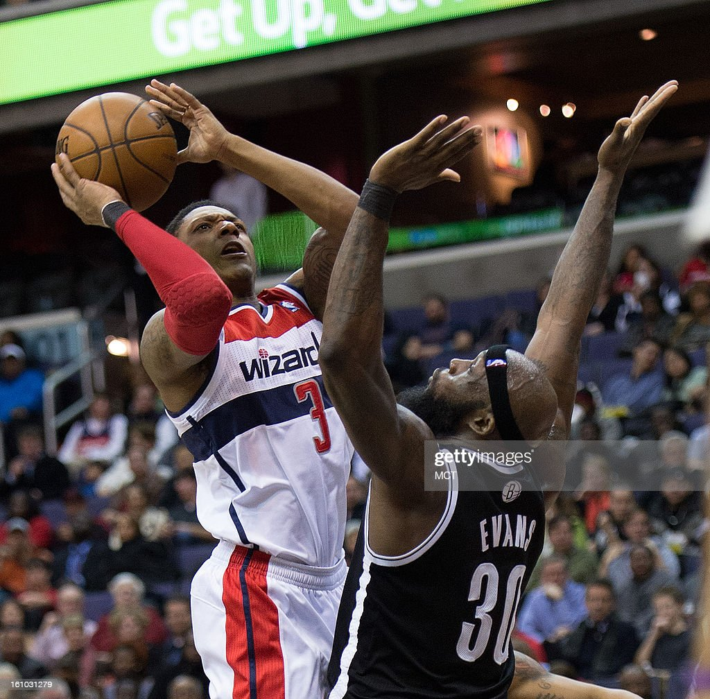 Washington Wizards shooting guard Bradley Beal (3) scores against Brooklyn Nets power forward Reggie Evans (30) during the second half of their game played at the Verizon Center in Washington, D.C., Friday, February 8, 2013. Washington defeated Brooklyn 89-74.