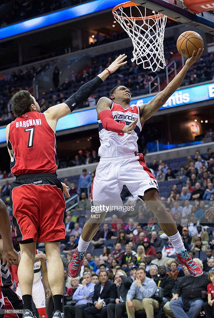 Washington Wizards shooting guard Bradley Beal (3) scores against Toronto Raptors center Andrea Bargnani (7) during the second half of their game played at the Verizon Center in Washington, D.C., Tuesday, February 19, 2013. Toronto defeated Washington 96-88.