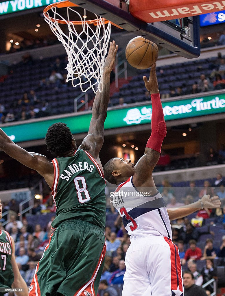 Washington Wizards shooting guard Bradley Beal (3) shoots a reverse layup over Milwaukee Bucks center Larry Sanders (8) during the second half of their game played at the Verizon Center in Washington, D.C., Friday, November 9, 2012. Milwaukee defeated Washington 101-91.