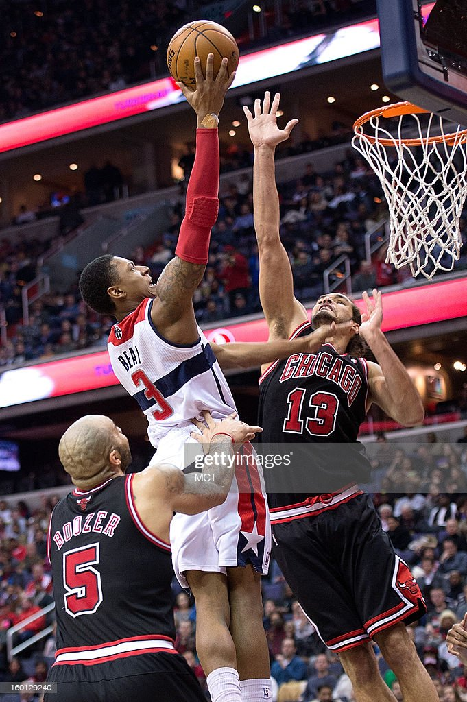 Washington Wizards shooting guard Bradley Beal (3) shoots over Chicago Bulls center Joakim Noah (13), and power forward Carlos Boozer (5) during the second half of their game played at the Verizon Center in Washington, D.C., Saturday, January 26, 2013. Washington defeated Chicago 86-73.
