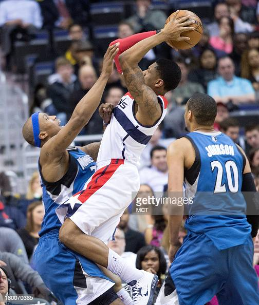 Washington Wizards shooting guard Bradley Beal shoots over Minnesota Timberwolves power forward Dante Cunningham while power forward Chris Johnson...