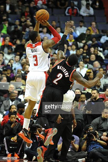 Washington Wizards shooting guard Bradley Beal takes a shot over Portland Trail Blazers Wesley Matthews during the first half at the Verizon Center...
