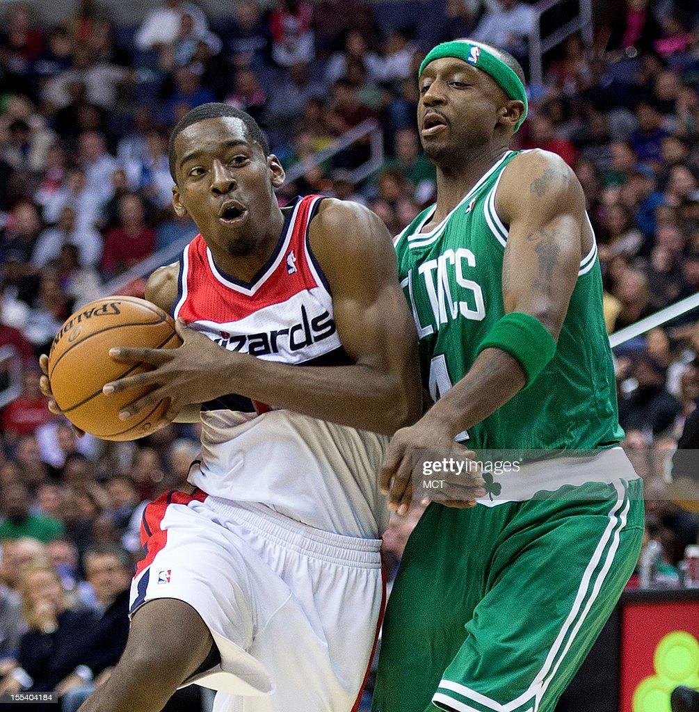 Washington Wizards shooting guard Jordan Crawford (15) drives past Boston Celtics shooting guard Jason Terry (4) during the second half of their game played at the Verizon Center in Washington, D.C., Saturday, November 3, 2012. Boston defeated Washington 89-86.