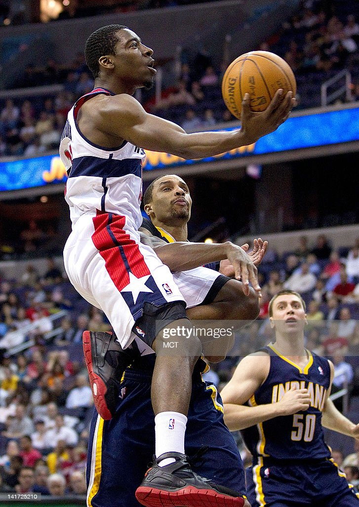 Washington Wizards shooting guard Jordan Crawford drives to the basket past Indiana Pacers shooting guard George Hill during the first half of their...