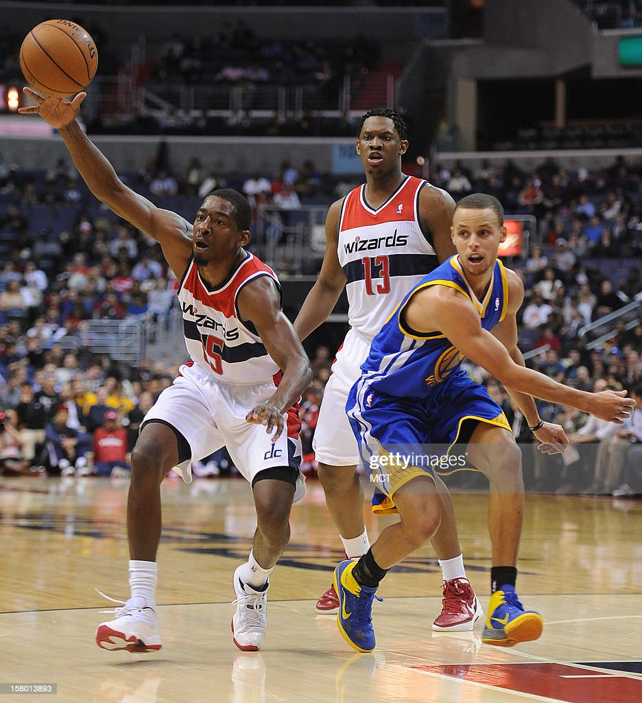 Washington Wizards shooting guard Jordan Crawford (15) gets a pass off against Golden State Warriors point guard Stephen Curry (30), right, in the third quarter at the Verizon Center in Washington, D.C., Saturday, December 8, 2012. The Warriors defeated the Wizards, 101-97.