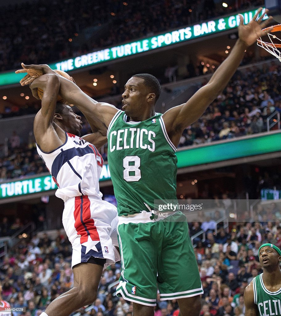 Washington Wizards shooting guard Jordan Crawford (15) is fouled by Boston Celtics power forward Jeff Green (8) during the second half of their game played at the Verizon Center in Washington, D.C., Saturday, November 3, 2012. Boston defeated Washington 89-86.