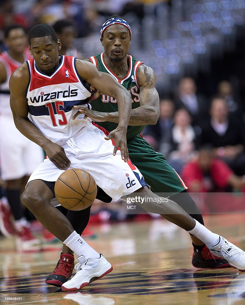 Washington Wizards shooting guard Jordan Crawford (15) is guarded closely by Milwaukee Bucks shooting guard Marquis Daniels (6) during the first half of their game played at the Verizon Center in Washington, D.C., Friday, November 9, 2012.