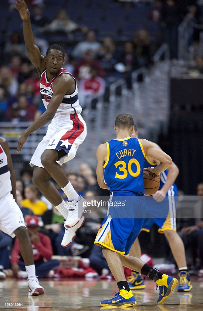 Washington Wizards shooting guard Jordan Crawford (15), right, elevates while guarding Golden State Warriors point guard Stephen Curry (30) in the third quarter at the Verizon Center in Washington, D.C., Saturday, December 8, 2012. The Warriors defeated the Wizards, 101-97.