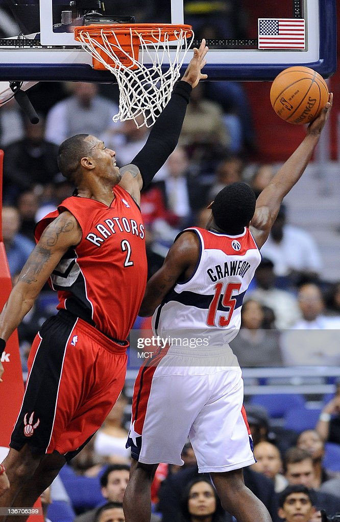 Washington Wizards shooting guard Jordan Crawford shoots and scores against Toronto Raptors small forward James Johnson during firsthalf action at...