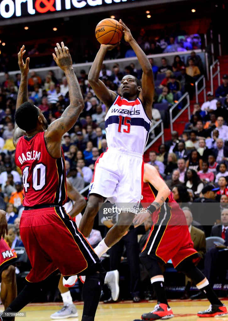Washington Wizards shooting guard Jordan Crawford (15) shoots over Miami Heat power forward Udonis Haslem (40) in the third quarter at the Verizon Center in Washington, D.C., Tuesday, December 4, 2012.