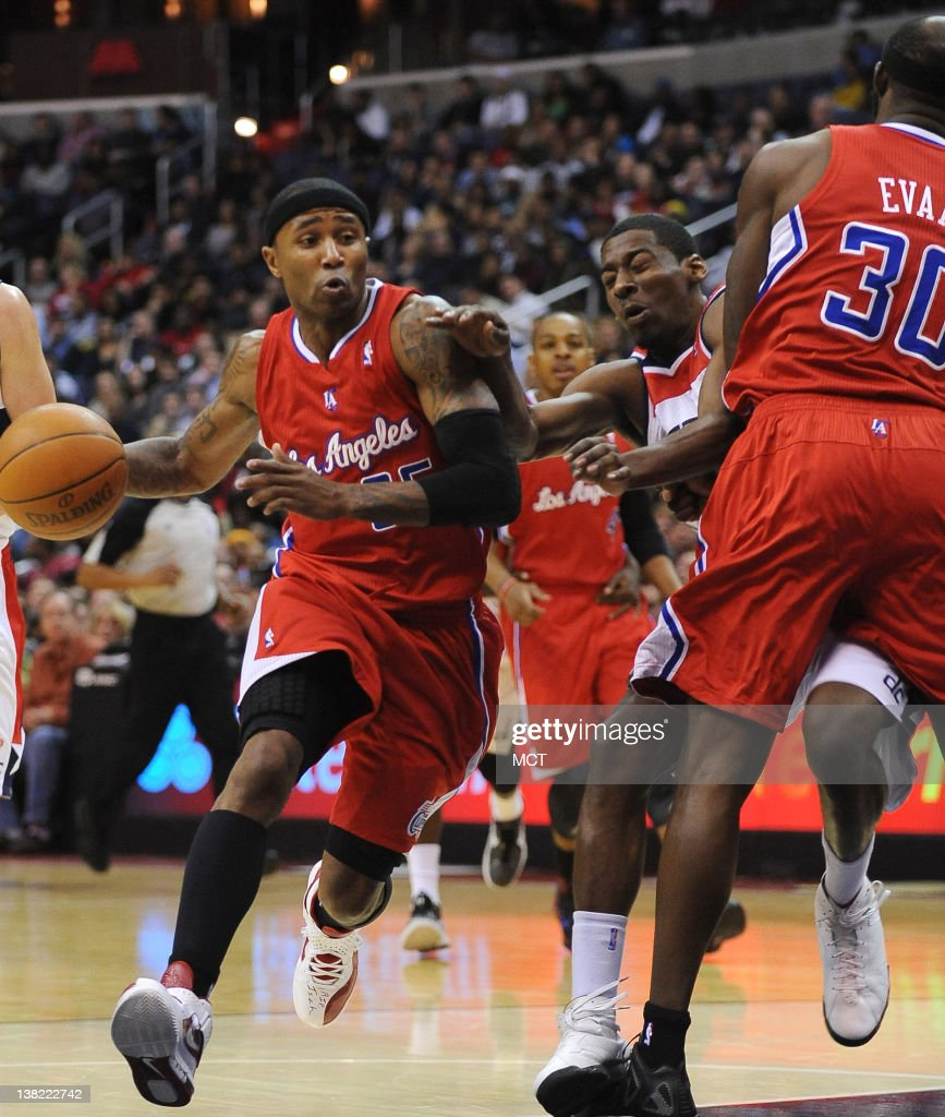Washington Wizards shooting guard Jordan Crawford slams into Los Angeles Clippers power forward Reggie Evans as he attempts to defend Clippers point...