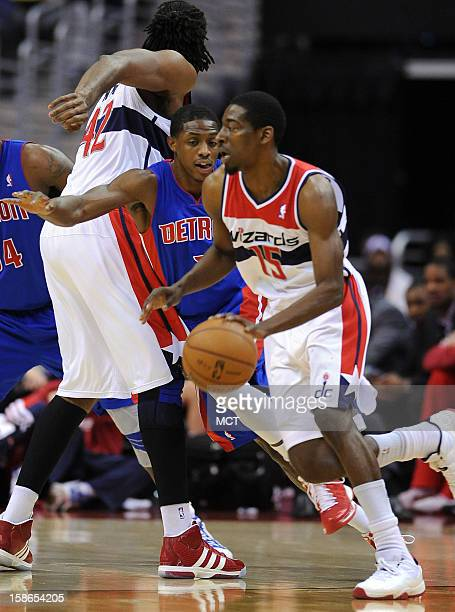 Washington Wizards shooting guard Jordan Crawford uses a screen by Washington Wizards center Nene to shed Detroit Pistons defender Brandon Knight in...