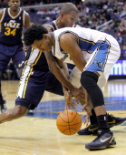 Washington Wizards shooting guard Nick Young and Utah Jazz shooting guard Raja Bell battle for the ball during their game played at the Verizon...