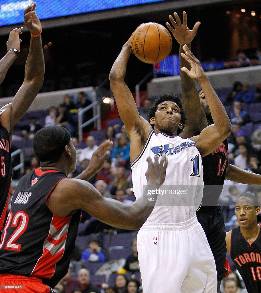 Washington Wizards shooting guard Nick Young (1) drives to the basket against Toronto Raptors power forward Ed Davis (32) during their game played at the Verizon Center in Washington, D.C., Saturday, January 15, 2011. Washington defeated Toronto 98-95.