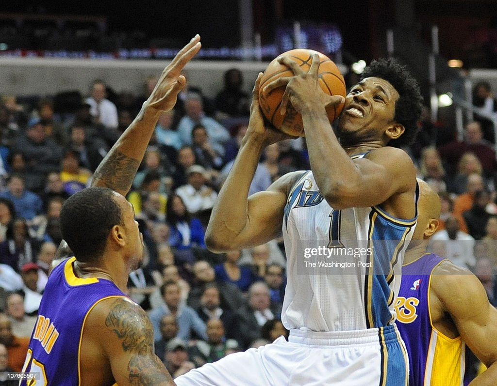 Washington Wizards shooting guard Nick Young goes up for two over Los Angeles Lakers point guard Shannon Brown during the game at the Verizon Center...