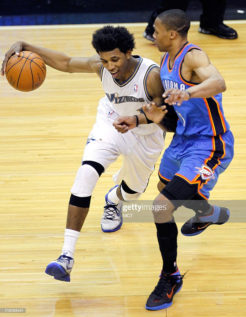 Washington Wizards shooting guard Nick Young (1) is guarded by Oklahoma City Thunder point guard Russell Westbrook (0) during their game played at the Verizon Center in Washington, D.C., Monday, March 14, 2011. Oklahoma defeated Washington 116-89.