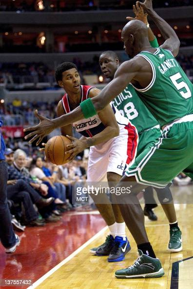 Washington Wizards shooting guard Nick Young is swarmed by Boston Celtics power forward Kevin Garnett and small forward Mickael Pietrus rear during...