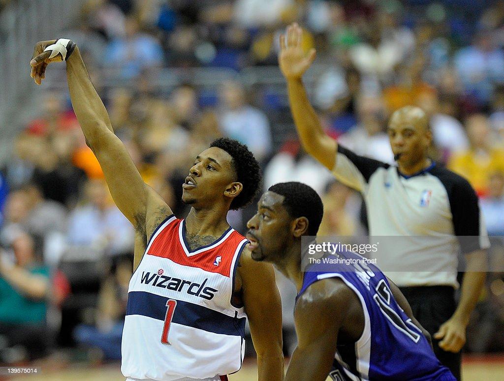 Washington Wizards shooting guard Nick Young (1), left, sinks a 3 pointer againstSacramento Kings point guard Tyreke Evans (13) as the Washington Wizards play the Sacramento Kings at the Verizon Center in Washington DC, February 22, 2012.