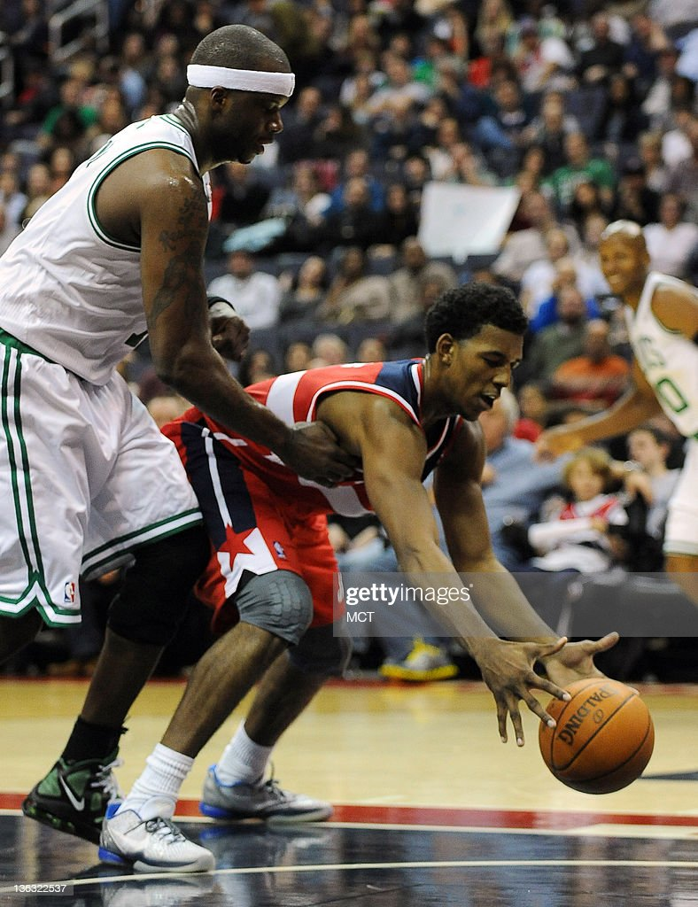 Washington Wizards shooting guard Nick Young (1) scoops up a loose ball against Boston Celtics center Jermaine O'Neal (7) during first-half action at the Verizon Center in Washington, D.C., Sunday, January 1, 2012.