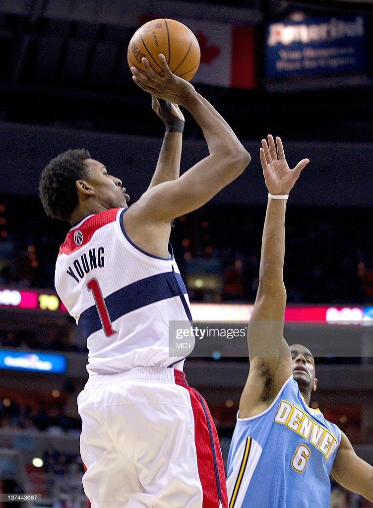 Washington Wizards shooting guard Nick Young (1) shoots over Denver Nuggets shooting guard Arron Afflalo (6) during their game played at the Verizon Center in Washington, D.C., Friday, January 20, 2012. Denver defeated Washington 108-104.