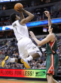 Washington Wizards shooting guard Nick Young shoots over Milwaukee Bucks power forward Ersan Ilyasova during their game played at the Verizon Center...