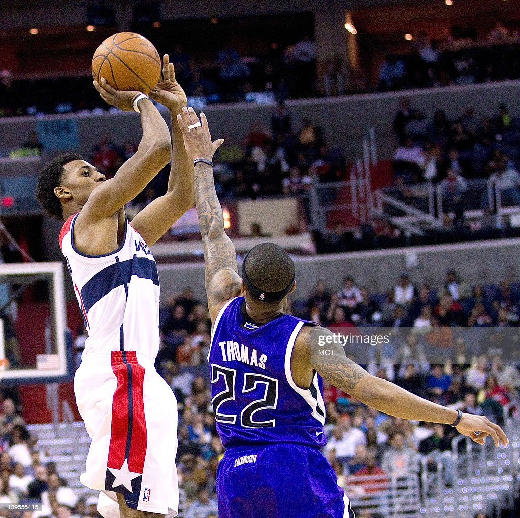 Washington Wizards shooting guard Nick Young (1) shoots over Sacramento Kings point guard Isaiah Thomas (22) during the second half of their game played at the Verizon Center in Washington, D.C., Wednesday, February 22, 2012. Sacramento defeated Washington 115-107.