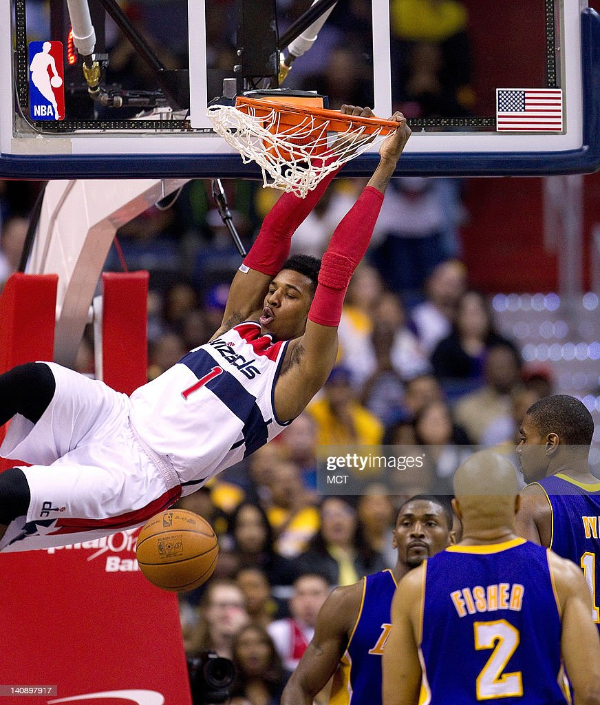Washington Wizards shooting guard Nick Young (1) slam dunks against the Los Angeles Lakers during the first half of their game played at the Verizon Center in Washington, D.C., Wednesday, March 7, 2012.