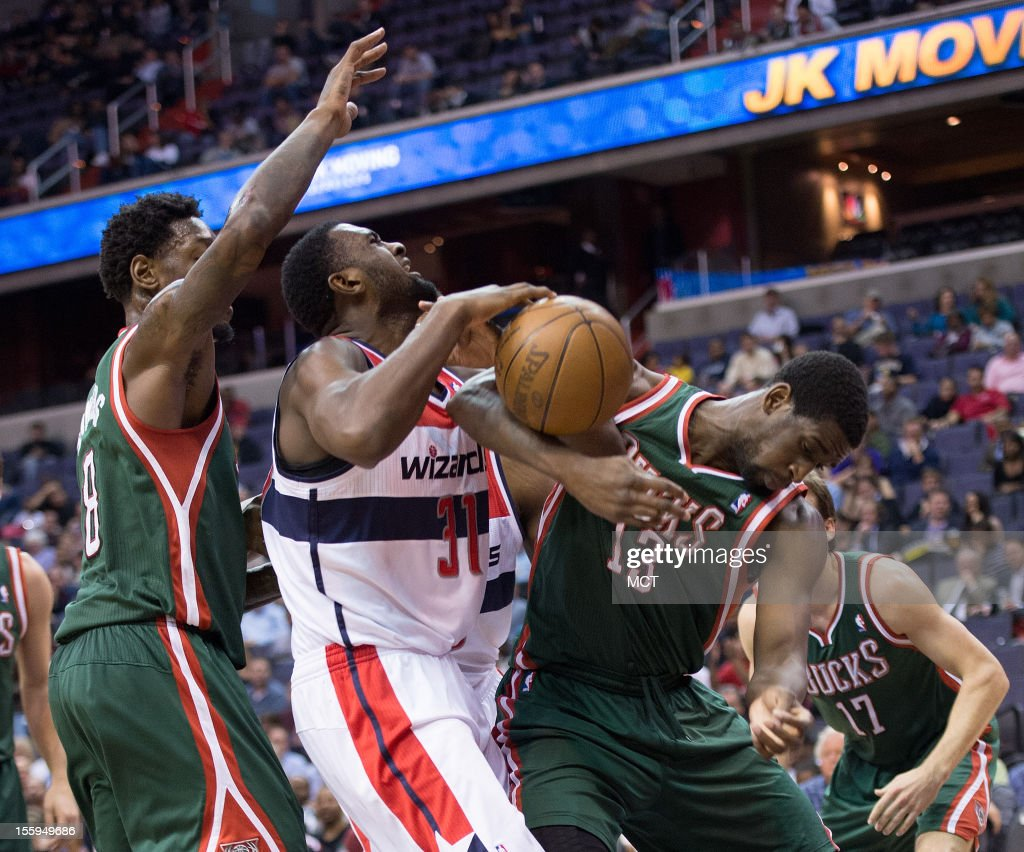 Washington Wizards small forward Chris Singleton (31), center battles for the ball between Milwaukee Bucks center Larry Sanders (8), left and power forward Ekpe Udoh (13) during the second half of their game played at the Verizon Center in Washington, D.C., Friday, November 9, 2012. Milwaukee defeated Washington 101-91.